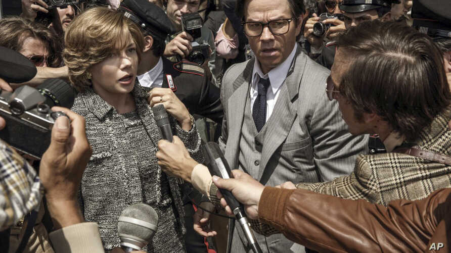 """FILE - This image from Sony Pictures shows Michelle Williams, left, and Mark Wahlberg in """"All The Money in the World."""" After an outcry over a significant disparity in pay with Williams, Wahlberg has agreed to donate the $1.5 million he earned for res"""