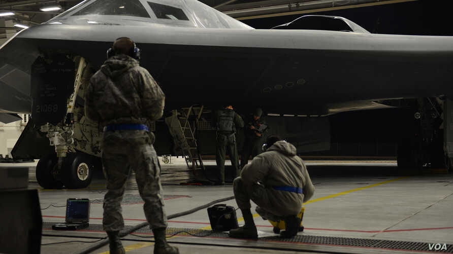 Airmen from the 509th Bomb Wing at Whiteman Air Force Base, Missouri prepare B-2 Spirit stealth bombers for operations near Sirte, Libya.