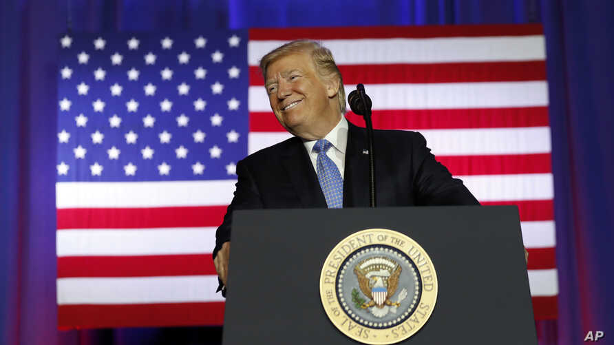 President Donald Trump pauses while speaking about tax reform at the Farm Bureau Building at the Indiana State Fairgrounds, Sept. 27, 2017, in Indianapolis.