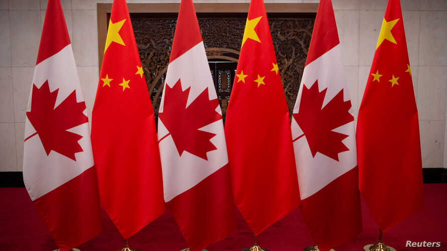 Picture of Canadian and Chinese flags taken prior to the meeting with Canada's Prime Minister Justin Trudeau and China's President Xi Jinping at the Diaoyutai State Guesthouse on December 5, 2017, in Beijing.