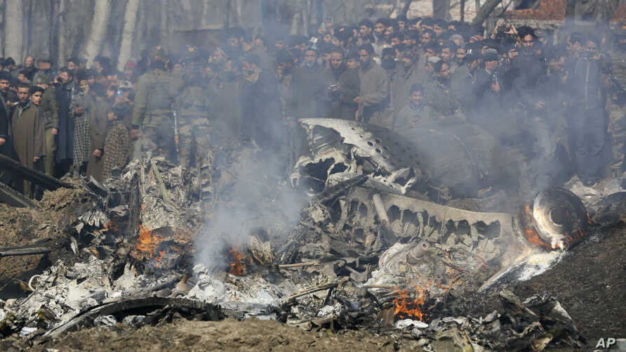 Kashmiri villagers gather near the wreckage of an Indian aircraft after it crashed in Budgam area, outskirts of Srinagar, Indian-controlled Kashmir, Feb.27, 2019.