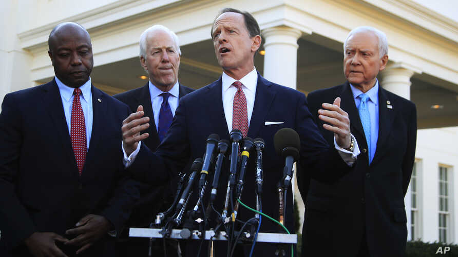 Senate Finance Committee member Sen. Patrick Toomey, R-Pa., second from right, with, from left, Sens. Tim Scott, R-S.C., John Cornyn, R-Texas,, and Chairman Orrin Hatch, R-Utah, speaks to reporters following a meeting with President Donald Trump at t...