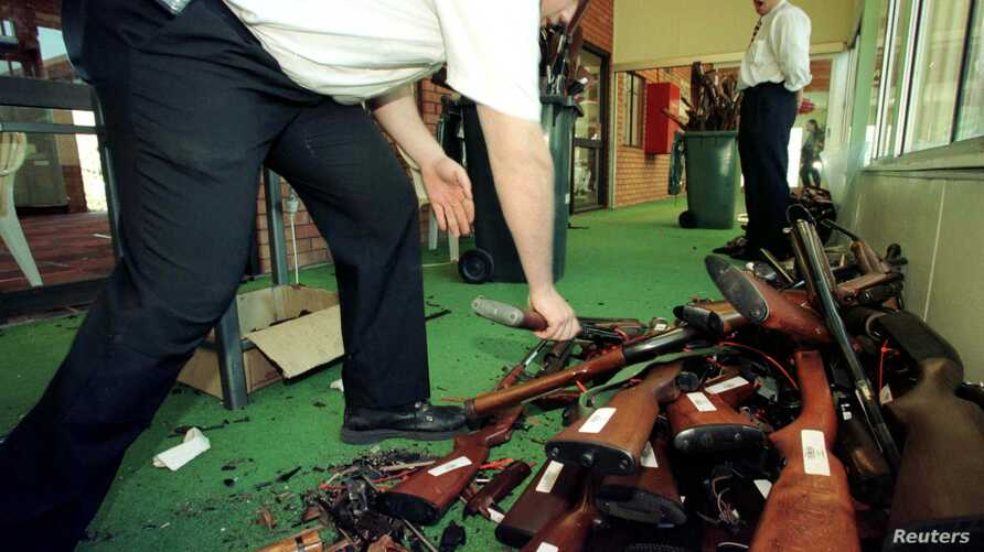 FILE - Guns that have just had their barrels crushed in Sydney are stacked after they were handed over on the last day of the Australian gun buy-back scheme, Sept. 30, 1997.
