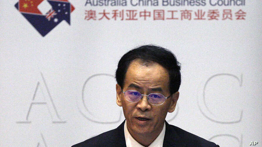 FILE - Chinese Ambassador to Australia, Cheng Jingye, gives a speech to a business forum in Australia's Parliament House in Canberra, Tuesday, June 19, 2018.