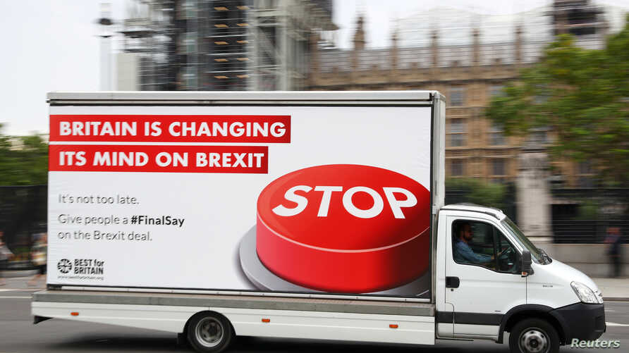 A van with a campaign poster about Brexit is driven around Parliament Square in London, Britain, Sept. 4, 2018.