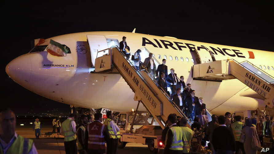 FILE - Passengers exit an Air France plane after it landed at Tehran's Imam Khomeini International Airport, south of the capital Tehran, Iran.