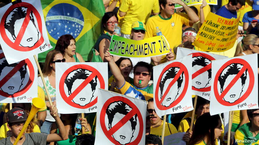 Demonstrators attend a protest against Brazil's President Dilma Rousseff, part of nationwide protests calling for her impeachment, at Paulista Avenue in Sao Paulo's financial centre, Brazil, August 16, 2015