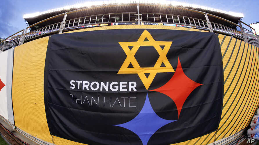 "A ""Stronger Than Hate"" banner is displayed on the sidelines before an NFL Football game, Nov. 8, 2018, at Heinz Field in Pittsburgh. It's a memorial to the 11 people killed in a synagogue on Oct. 27, 2018."