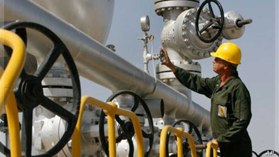 Iranian oil technician Majid Afshari, checks the oil separator facilities in Azadegan oil field, some 480 miles (800 kilometers) southwest of the capital, Tehran, Iran, Tuesday, April 15, 2008.