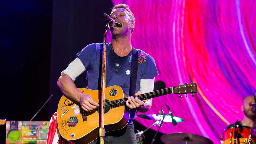 FILE - Chris Martin of Coldplay performs at The Budweiser Made In America Festival in Philadelphia.