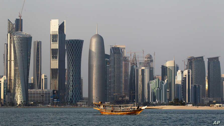 FILE - A traditional dhow floats in the Corniche Bay of Doha, Qatar, Jan. 6, 2011. Saudi media reported April 9, 2018, a proposal to dig a maritime canal along the kingdom's closed border with Qatar, turning the peninsula-nation into an island and fu