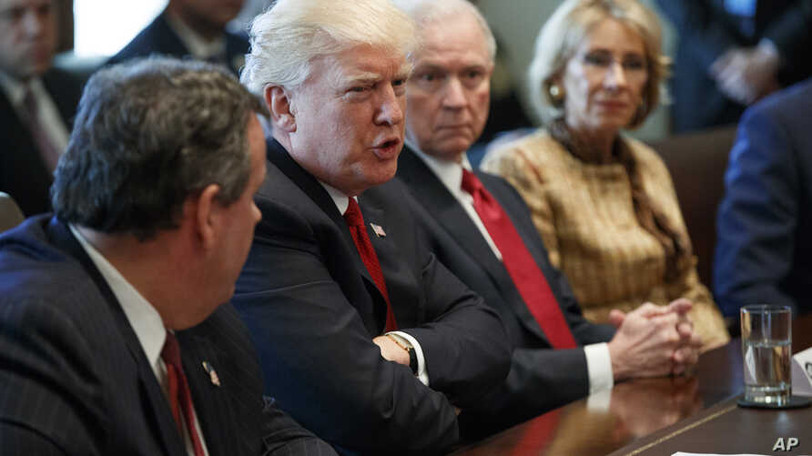 President Donald Trump speaks during an opioid and drug abuse listening session, March 29, 2017, in the Cabinet Room of the White House in Washington. From left are, New Jersey Governor Chris Christie, Trump, Attorney General Jeff Sessions, and Educa