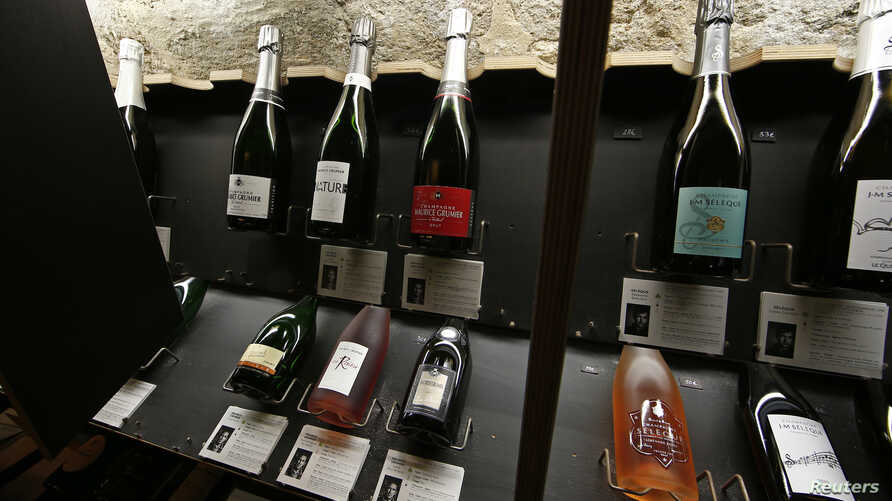Bottles of Champagne are displayed at Dilettantes wine shop in Paris, France, Dec. 31, 2015.