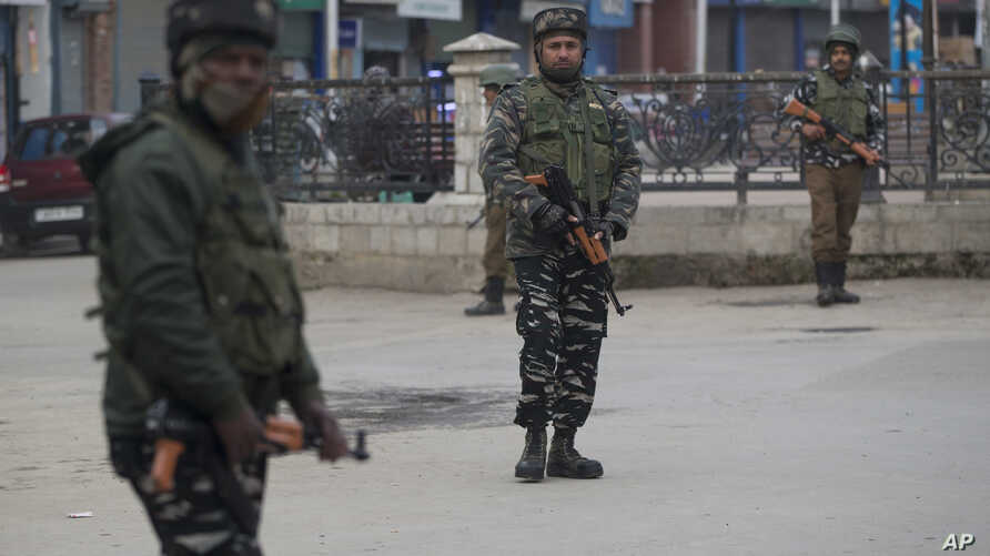 Indian paramilitary soldiers stand guard in a closed market in Srinagar, Indian-controlled Kashmir, Feb. 23, 2019.