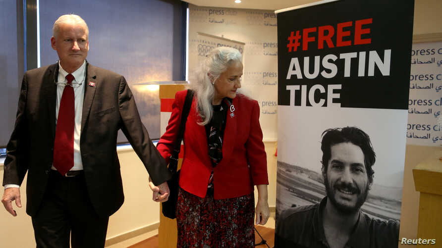 Marc and Debra Tice, parents of U.S. journalist Austin Tice, walk past a poster of their son after the news conference in Beirut, Lebanon, Dec. 4, 2018.