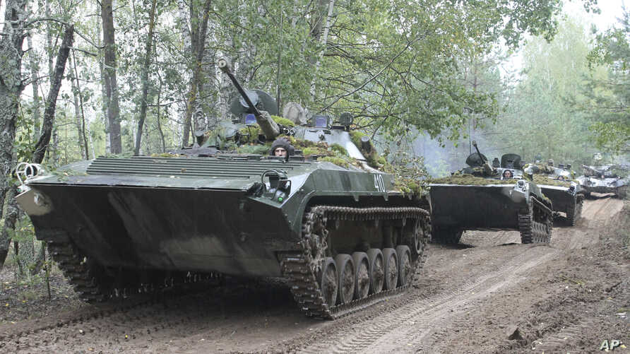 In this photo taken on Friday, Sept. 15, 2017, Belarusian army vehicles drive during the war games at an undisclosed location in Belarus. Russia and Belarus began major war games Thursday, an operation involving thousands of troops, tanks and aircraf