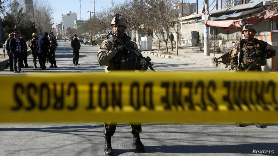 Afghan security forces keep watch at the site of a suicide attack in Kabul, Afghanistan, Dec. 28, 2017.