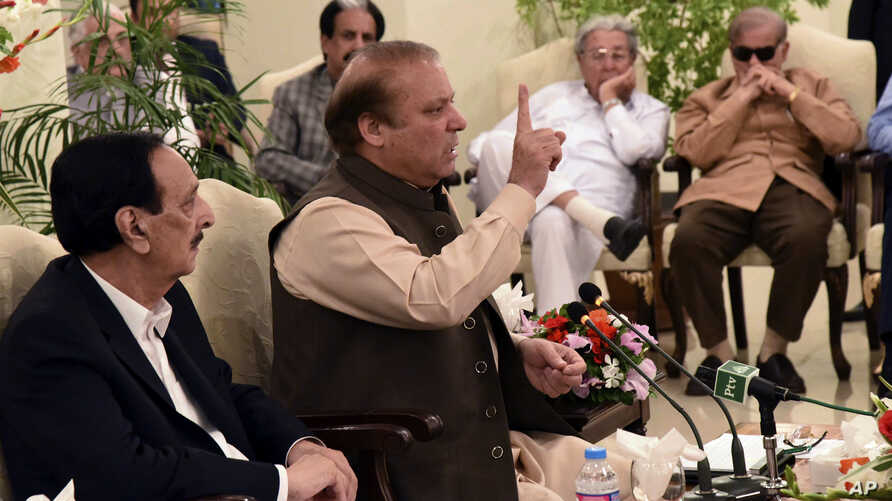 This photo released by Pakistan's Muslim League shows ousted Pakistani Prime Minister Nawaz Sharif addressing party members in Islamabad, Pakistan, July 29, 2017.
