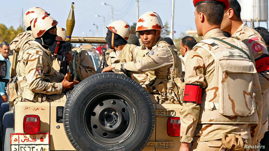 FILE - Military forces look on in North Sinai, Egypt, Dec. 1, 2017.