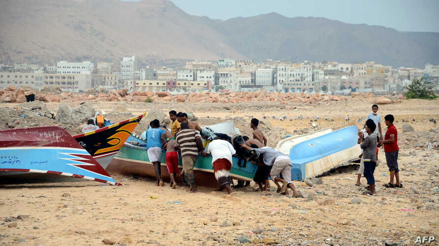 Yemeni fishermen push a boat to shore as they prepare for tropical cyclone Megh, in the southern city of Mukalla in Yemen's Hadramawt province, Nov. 9, 2015.
