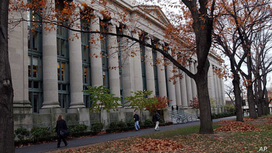 FILE - Students walk through the Harvard Law School area on the campus of Harvard University in Cambridge, Mass.