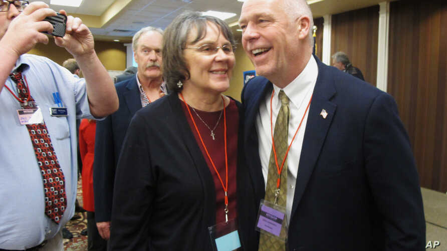 FILE -Greg Gianforte, right, receives congratulations from a supporter, March 6, 2017, in Helena, Mont., after winning the Republican nomination for Montana's special election for U.S. House. The technology entrepreneur defeated Democratic nominee Ro...