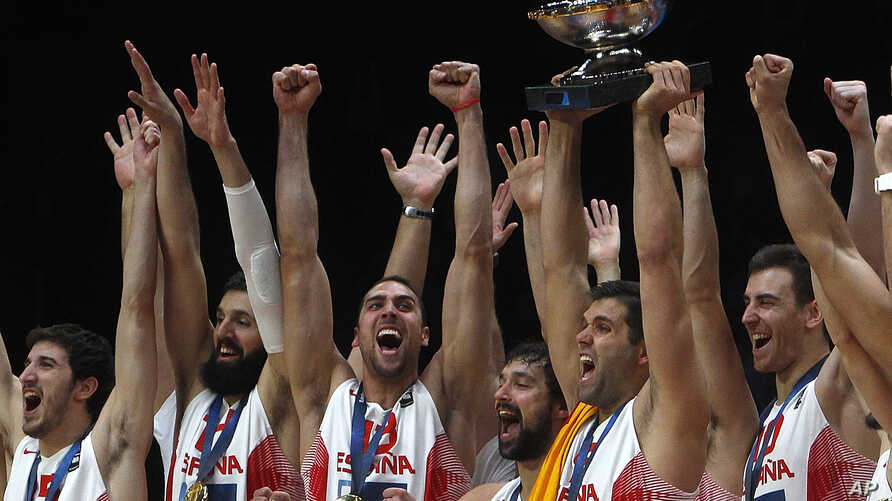 Spain' s Felipe Reyes holds the cup while teammates celebrate after winning the Eurobasket European Championship final between Spain and Lithuania in Lille, northern France, Sunday, Sept. 20, 2015.