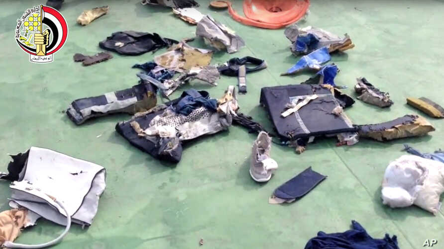 FILE - This file still image taken from video posted Saturday, May 21, 2016, on the official Facebook page of the Egyptian Armed Forces spokesman shows some personal belongings and other wreckage from EgyptAir flight 804 in Egypt.