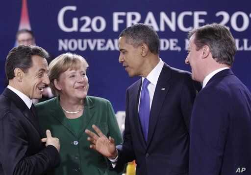 President Barack Obama speaks with, from left, French President Nicolas Sarkozy, German Chancellor Angela Merkel, and British Prime Minister David Cameron; during a working lunch at the G20 Summit in Cannes, France, Thursday, Nov. 3, 2011.