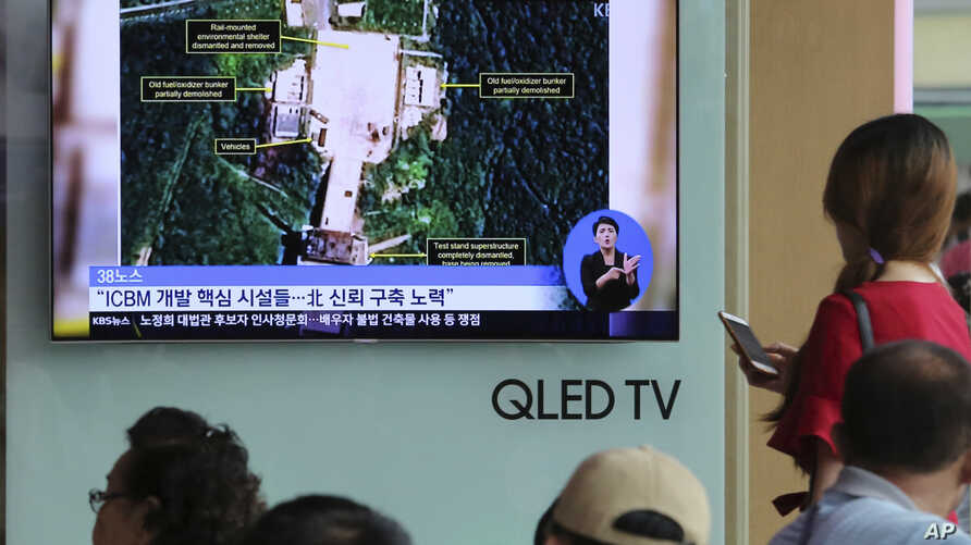 FILE - A TV screen shows a satellite image of a North Korean missile launch site, during a news program at the Seoul Railway Station in Seoul, South Korea, July 24, 2018.