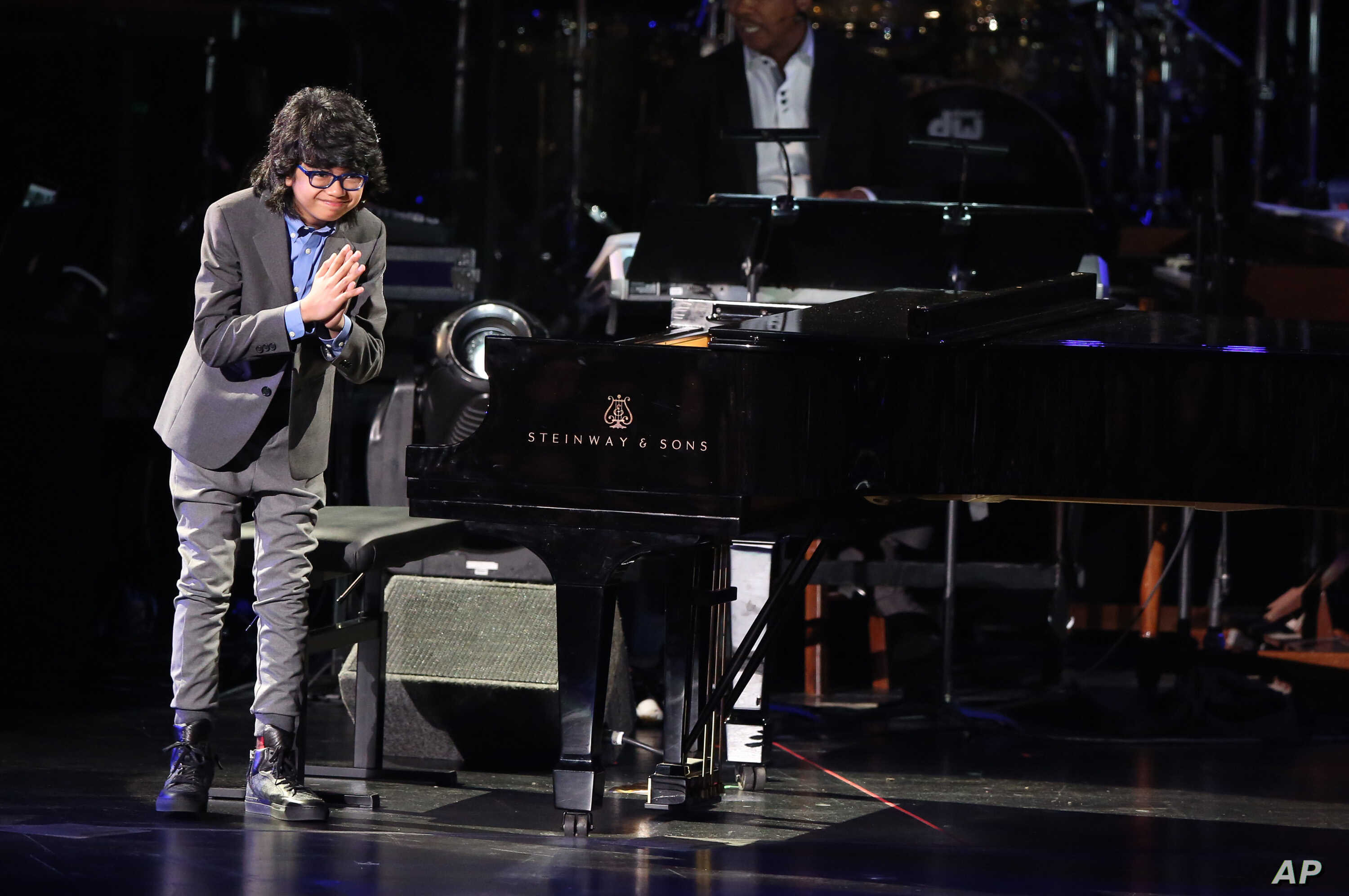 Joey Alexander performs at the 58th annual Grammy Awards, Feb. 15, 2016, in Los Angeles.