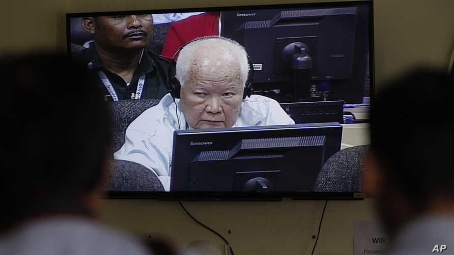 Khieu Samphan, former Khmer Rouge head of state, is seen on screen at the court's press center at the U.N.-backed war crimes tribunal on the outskirts of Phnom Penh, Cambodia, Nov. 16, 2018.