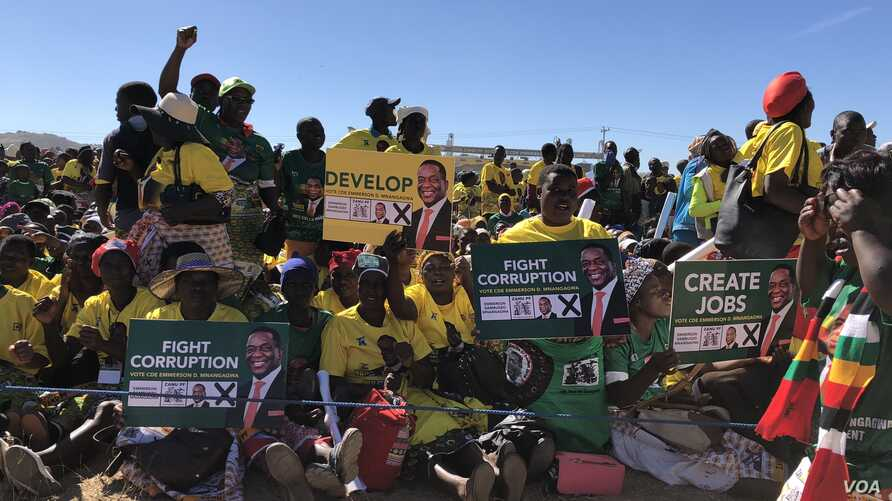 Members of Zanu PF rally in Mutoko, about 200km east of Harare displaying to President Emmerson Mnangagwa on June 9, 2018 what they want him address if he wins the July 30th Zimbabwe general election