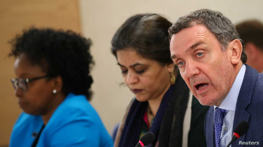 Santiago Canton, right, Chair of the Commission of Inquiry on the 2018 protests in the occupied Palestinian territory, attends next to Sara Hossain, left, and Kaari Betty Murungi for a session of the Human Rights Council at the U.N. in Geneva, March