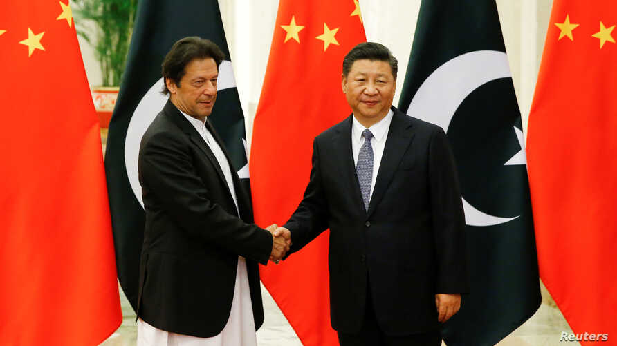 Chinese President Xi Jinping meets Pakistani Prime Minister Imran Khan at the Great Hall of the People in Beijing, Nov. 2, 2018.