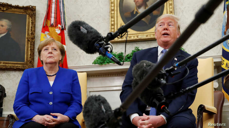 U.S. President Donald Trump meets with German Chancellor Angela Merkel in the Oval Office in Washington, April 27, 2018.