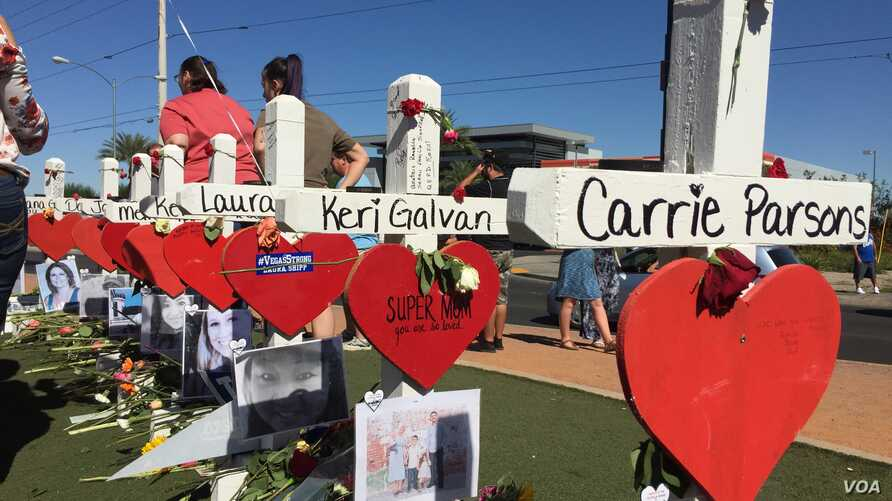 "The crosses, erected in a graceful, curvy line behind the ""Welcome to Las Vegas"" sign, serve as markers of the lives of those who died when a gunman opened fire Oct. 1, 2017, at the crowd attending a country music concert in Las Vegas. Many visi..."