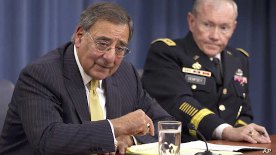 Defense Secretary Leon Panetta and Joint Chiefs Chairman Gen. Martin Dempsey take part in a news conference at the Pentagon in Washington (file photo).
