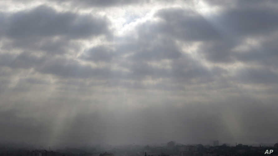 Gaza City, northern Gaza Strip, is seen shortly before the start of a proposed cease-fire, Friday, Aug 1, 2014. Palestinian officials say more than 15 Palestinians were killed in Israeli strikes ahead of the planned three-day cease-fire in the Gaza w