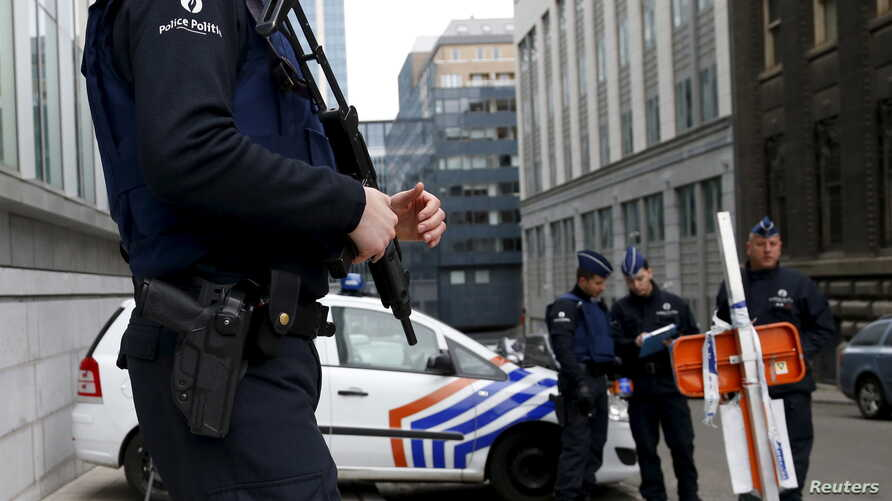 Belgian police officers secure an access to the federal police headquarters in Brussels, March 19, 2016, after Salah Abdeslam, the most-wanted fugitive from November's Paris attacks, was arrested after a shootout with police in Brussels on Friday.   ...