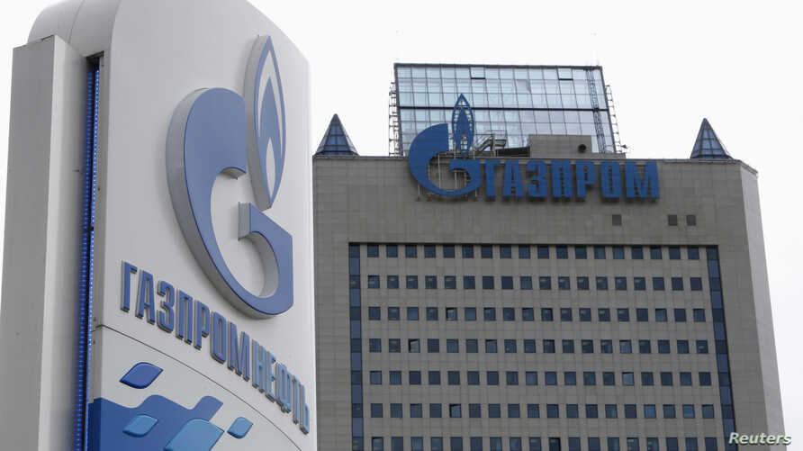 FILE - A general view shows the headquarters of Gazprom, with a board of Gazprom Neft, the oil arm of Gazprom seen in the foreground, on the day of the annual general meeting of the company's shareholders in Moscow.