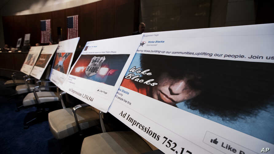 Facebook ads linked to a Russian effort to disrupt the American political process are displayed at a House Intelligence Committee hearing on Capitol Hill in Washington, Nov. 1, 2017.