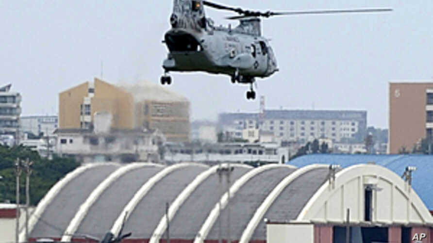 US Marines' CH-46E helicopter takes off from the US Marine Corps Air Station Futenma in Ginowan, Okinawa prefecture. (File 2010)