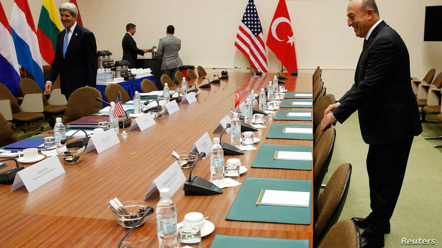 FILE - A U.S. and a Turkish flag are seen ahead of the start of a meeting between American and Turkish officials in Brussels, Belgium, Dec. 20, 2015.
