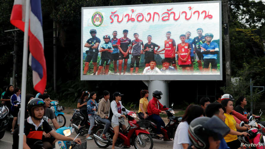 """A board showing """"Welcome home, boys"""", is seen after rescue effort has begun for the 12 schoolboys and their soccer coach trapped in Tham Luang cave, in Chiang Rai, Thailand, July 9, 2018."""
