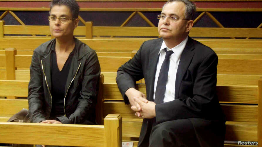 "FILE - =Jacob ""Kobi"" Alexander sits with his wife, Hanna, as he awaits the start of his extradition hearing in Windhoek, Namibia, Sept. 17, 2008."