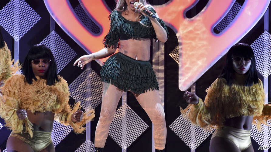 FILE - Hip-hop recording artist Cardi B performs at Z100's iHeartRadio Jingle Ball in New York on Dec. 7, 2018.