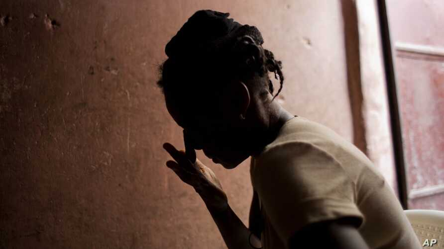 Martine Gestime 32, wipes her tears during an interview in Port-au-Prince, Haiti, Aug. 11, 2016. Gestime said she was raped by a Brazilian peacekeeper in 2008 and became pregnant with her son, Ashford. The medical charity Medecins Sans Frontieres say