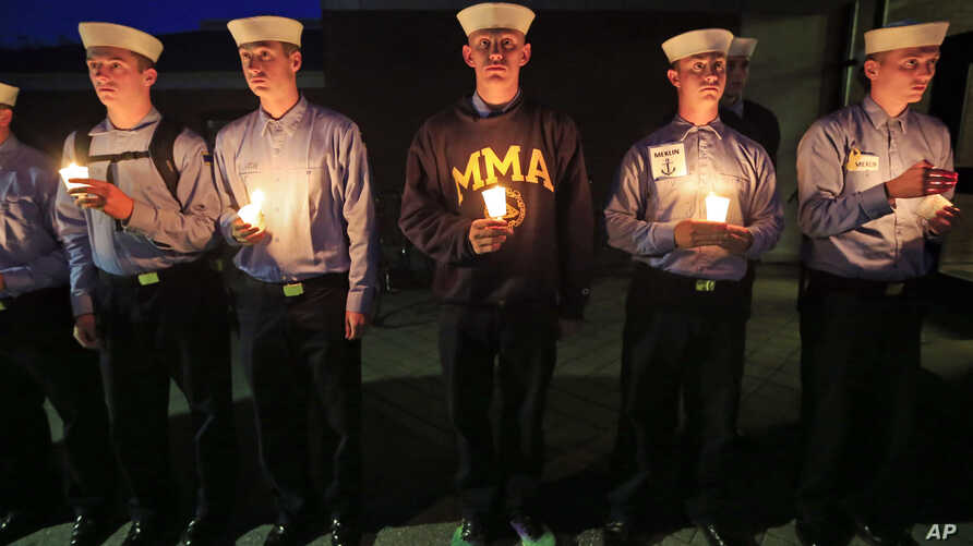 Maine Maritime Academy students attend a vigil of hope for the missing crew members of the U.S. container ship El Faro, Tuesday evening, Oct. 6, 2015.