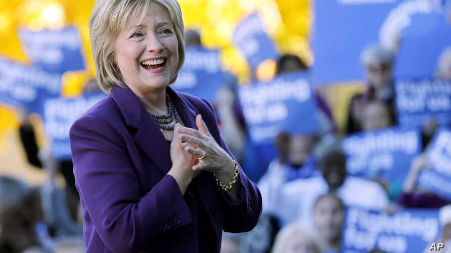 FILE - Democratic presidential candidate Hillary Rodham Clinton acknowledges supporters after filing papers to be on the nation's earliest presidential primary ballot in Concord, N.H., Nov. 9, 2015.
